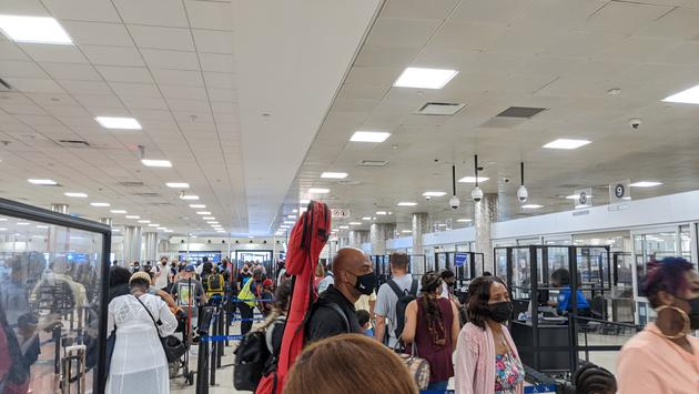 Travelers in security line at the airport
