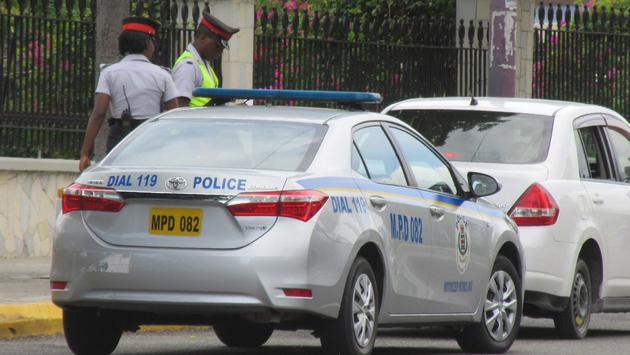 Jamaica police officers and their police car