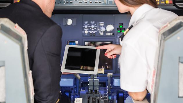 Pilots Checking Flight Information on Digital Tablet