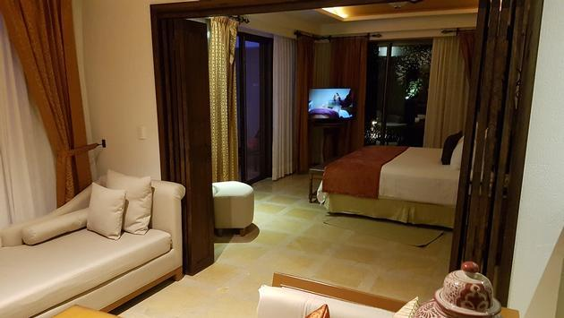 Looking into the bedroom of a Secrets Puerto Los Cabos Master Suite Swim-Out Ocean View.