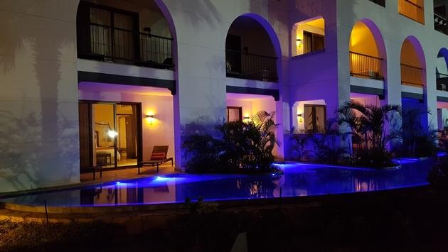 A nighttime view of the swim-up pool for the Master Suite Swim-Out Ocean View at Secrets Puerto Los Cabos.