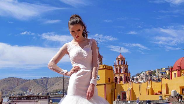 A bride poses in front of a historic church San Miguel de Allende, Guanajuato, Mexico.