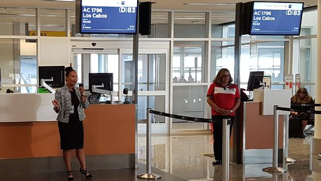 Marigold Frontuna, Air Canada Vacations' general manager, sales - western Canada, addresses the group at Calgary Airport before boarding the flight to Los Cabos.