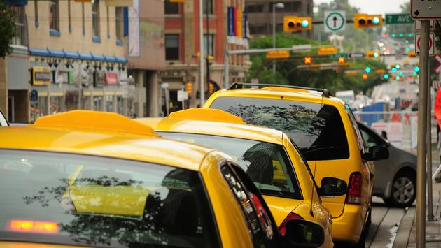 A row of taxis waiting to pick up passengers in Canada.