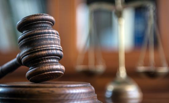 Judge's mallet and the scales of justice.