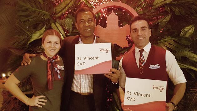 Fitgerald Huggins, Consul General of St. Vincent and the Grenadines in Toronto, poses with Air Canada Rouge inflight crew, Fallon and Rodrigo.
