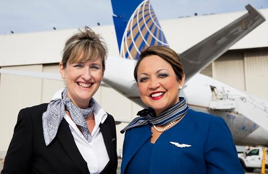 United flight attendants with airliner background