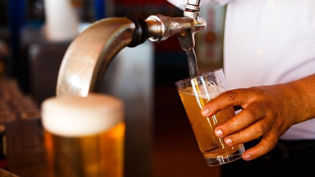 Pouring a draft beer