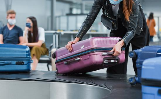 Travelers in airport during COVID-19 outbreak.