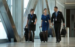 United flight attendants walk through Houston Bush Intercontinental Airport