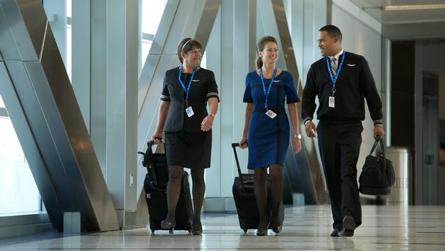 United flight attendants walk through Houston Bush Intercontinental Airport