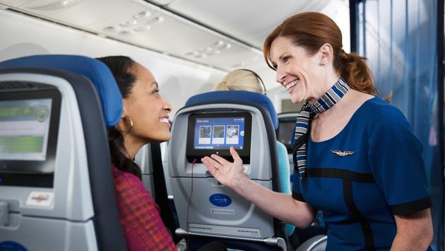 United flight attendant greeting passenger