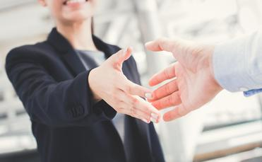 Businesswoman going in for a handshake