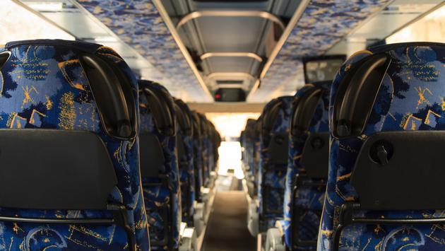 Empty seats on a tour bus
