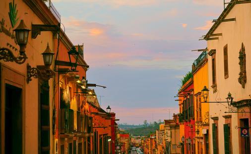 Colorful exteriors of homes along a corridor in San Miguel de Allende.