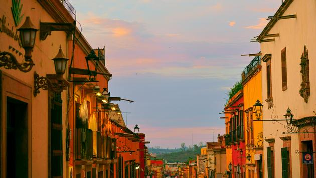 Colorful exteriors of homes along a corridor in San Miguel de Allende.