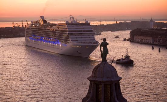 A cruise ship sailing the Giudecca Canal in Venice