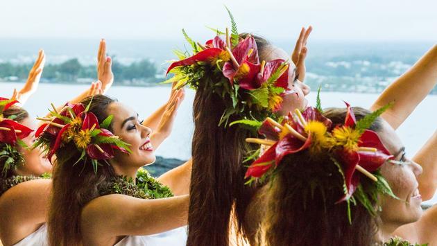 Hula halau dancers dressed for a performance