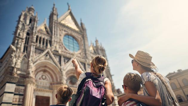 Tourist family sightseeing in Italy.