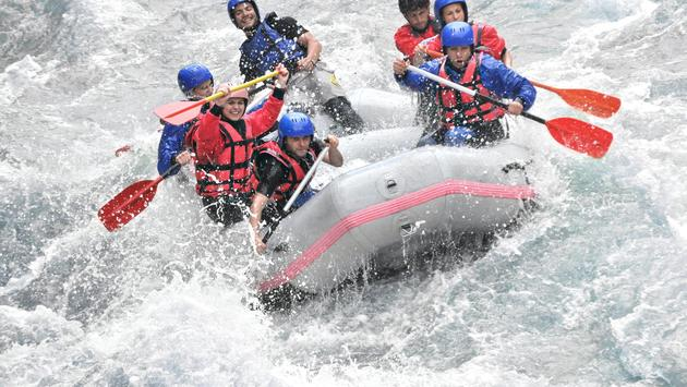 A group white water rafting