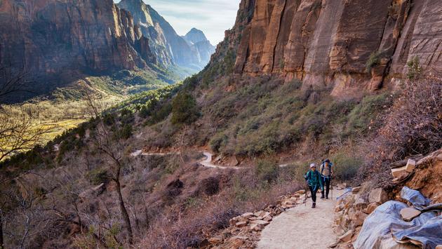Hikers traversing Angels Landing Trail at Utah's Zion National Park
