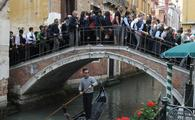 Editorial Use Only - Tourists in the crowded bridge in Venice, Italy