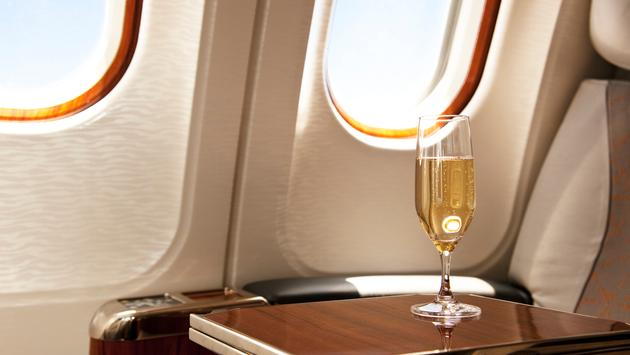 Champagne provided at a passenger's airplane seat.