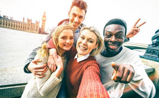 Group of friends taking a selfie in London.