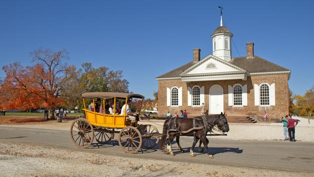 Horse-drawn carriage riding through Colonial Williamsburg