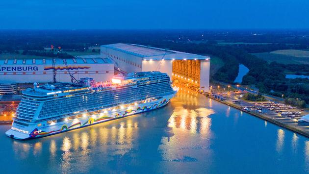 Norwegian Encore emerges from the Meyer Werft shipbuilding dock in Papenburg, Germany.