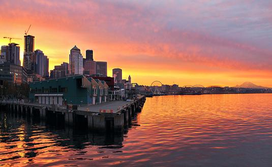 Orange sunrise over the Seattle skyline and waterfront