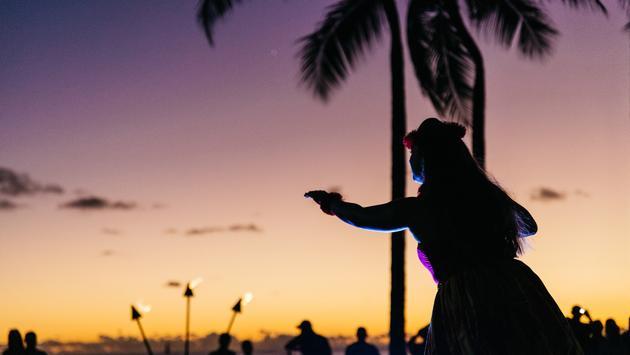Hula dancer on beach at sunset