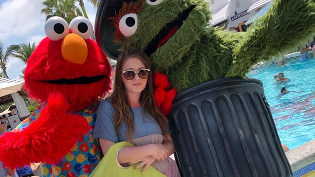 Sesame Street characters Elmo and Oscar the Grouch, Beaches