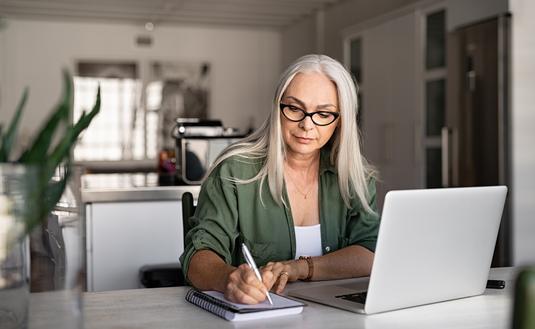 Travel advisor taking notes at home