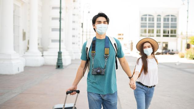 Couple in face masks on vacation in Mexico City.