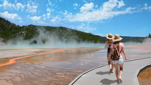Two girls hiking through Yellowstone National Park