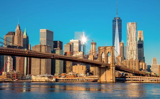 Skyline of downtown New York City and the Brooklyn Bridge.