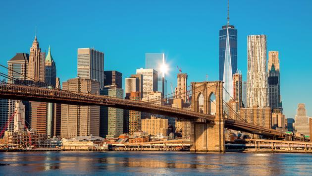 Nyc sets more tourism records travelpulse famous skyline of downtown new york brooklin bridge and manhattan at the early morning sun sciox Image collections