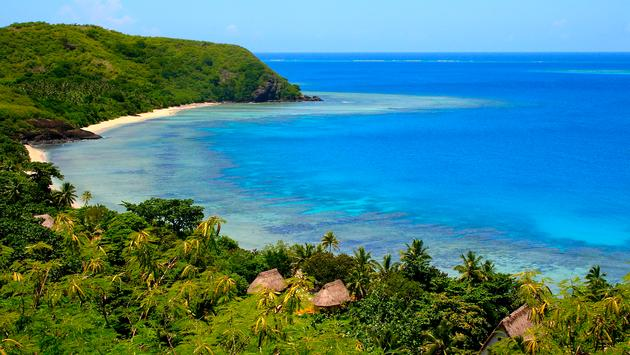 Aerial Yasawa Islands view, with turquoise beach and bungalow palapas