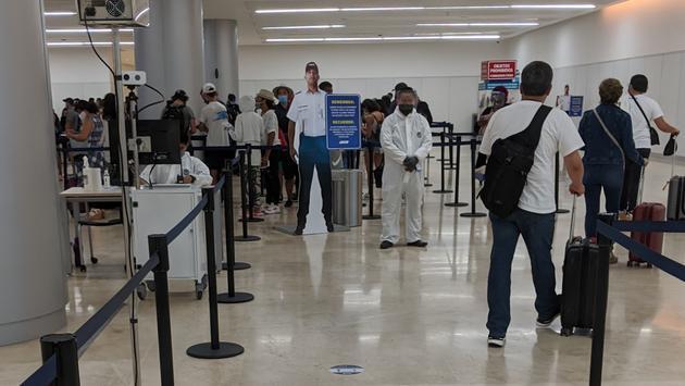 Cancun Airport using thermal screening