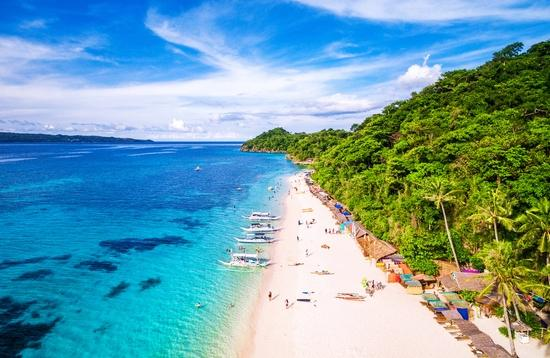 Aerial view of Puka beach in Boracay Island, Western Visayas, Philippines.