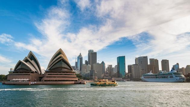 Sydney cityscape with Opera house and ferry boat