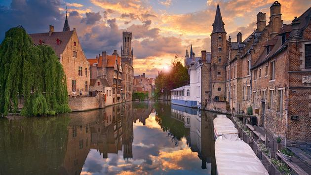 Image of famous most photographed location in Bruges, Belgium during dramatic sunset.