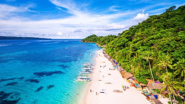 Aerial view of Puka beach in Boracay Island, Western Visayas, Philippines.