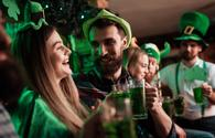 People celebrating St Patrick's Day at a pub