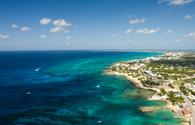 Aerial view of Grand Cayman overlooking George Town and Seven Mile Beach to the north.