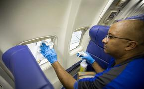 Southwest employee cleaning plane.