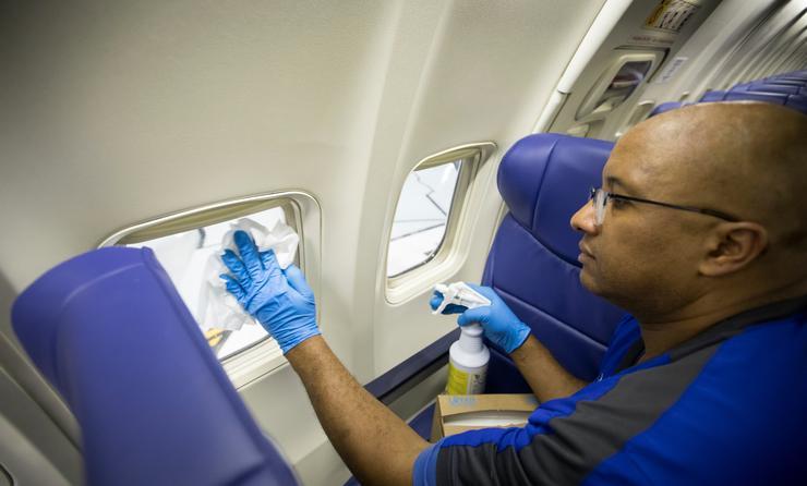 Southwest employee cleaning plane.