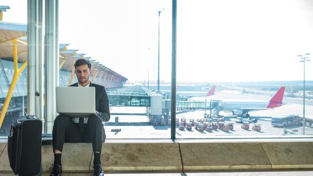 traveler, airport, laptop