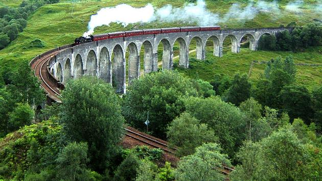 The Hogwarts Express crossing the Glenfinnan Viaduct in Scotland